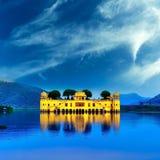 Indian water palace on Jal Mahal lake at night time in Jaipur royalty free stock photo