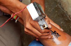 Indian way of tattoo process mostly done outdoors and road side Stock Images