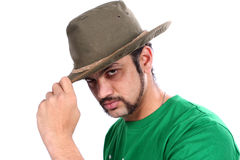 Indian Wearing a Hat. A cool Indian guy wearing a hat, on white studio background Royalty Free Stock Photos