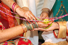 Indian Wedding. Hindu Bride's parents giving her hand in the hand of broom and tie up life long knot Royalty Free Stock Photos