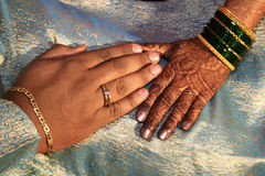 Indian Wedding. Hands with exchanged rings and placed together in a ritual, in an Indian wedding Royalty Free Stock Photography