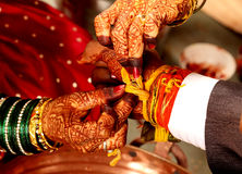 Indian wedding. Part of indian hindu wedding ceremony where the bride and groom are tied band together Royalty Free Stock Photography