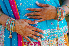 Indian wedding bride getting henna applied Royalty Free Stock Photo