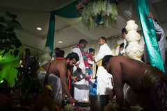 Indian Wedding Ceremony in Kuala Lumpur. Kuala Lumpur, Malaysia – November 2, 2014. Indian Wedding Ceremony. Solemnization of an Indian couple by Hindu monk in Stock Photography