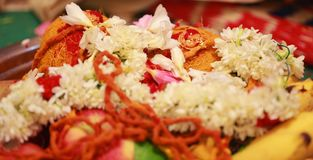 Mangal sutra with flowers in South Indian wedding ceremony. Indian wedding, closeup mangal sutra with flowers in South Indian wedding ceremony Royalty Free Stock Image