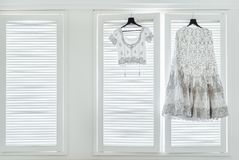 Indian Wedding Dress and Blouse hanging on the windows royalty free stock image