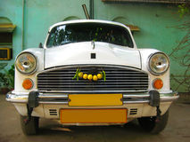 Indian white car Ambassador  taxi service Stock Image