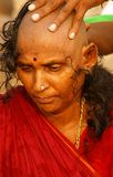 Indian widow - shavihg her head. Shaving of the head and other practices are part of a vow known as the vidava-vrata, undertaken by a widow in India. At the time Stock Image