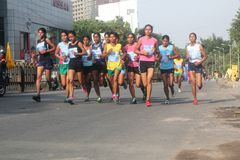 Indian woman athletes in bangalore marathon Stock Photo
