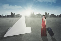 Indian woman with bag and paper plane Royalty Free Stock Photos