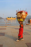 Indian woman with basket on her head walking by Man Sagar Lake i Stock Image