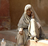 Indian woman begging - India. Indian woman begging on the streets of Delhi in India Royalty Free Stock Images