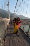 Indian woman with big package on Ram Jhula bridge Stock Photography