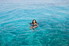 Indian woman in blue sea Royalty Free Stock Photography
