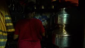 Indian woman boiling food stock video footage