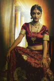 Indian woman in bridal wear stock images