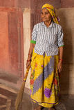Indian woman with a broom standing inside Humayun's Tomb, Delhi, Stock Photography