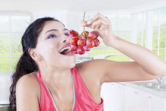 Indian woman with bunch of grapes Royalty Free Stock Images