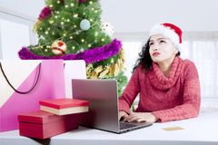 Indian woman buying Christmas gifts online Royalty Free Stock Images