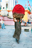 An Indian woman carries the basket Stock Photo