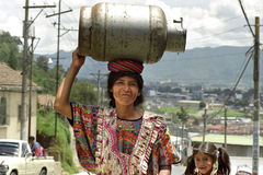 Indian woman carries gas cylinder on head Royalty Free Stock Photos