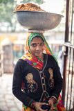 Indian woman carrying bowl on head Stock Photo