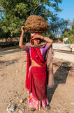 An Indian woman carrying clay for brick-making. On the head, India Royalty Free Stock Image