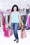 Indian woman carrying shopping bag at the store Stock Photography