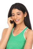 Indian  woman with cell phone Stock Photography