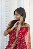 Indian Woman on Cell Phone Royalty Free Stock Images