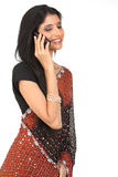 Indian woman with cellphone stock image