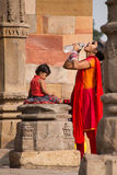 Indian woman with a child dringking water at Quwwat-Ul-Islam mos Royalty Free Stock Image