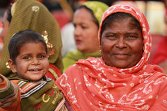 Indian Woman and Child. JAIPUR, INDIA, MARCH 4: An unidentified woman and child outside the City Palace on March 4, 2012 ahead of the annual Holi Festival in Stock Photos
