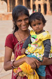 Indian woman with a child standing in the courtyard of Quwwat-Ul Royalty Free Stock Photos