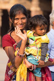Indian woman with a child standing in the courtyard of Quwwat-Ul Stock Photo