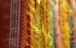 Indian woman clothes Sarees or Saris on hangers. Closeup of Indian woman clothes Sarees or Saris on hangers in a retail shop or store royalty free stock images