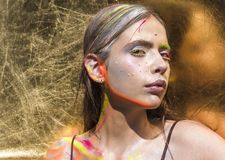 Indian woman with colorful neon paint makeup face stock photos