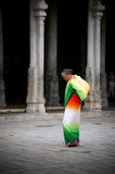 Indian woman in colorful sari carrying bale with offerings for religious ritual at Meenakshi Temple Royalty Free Stock Photo