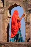Indian woman in colorful sari standing in the arch, Ranthambore Royalty Free Stock Photo