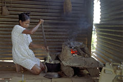 Indian woman cooking in kitchen at Coco River Royalty Free Stock Photo