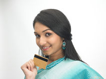Indian woman with credit card Royalty Free Stock Photos