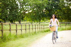 Indian Woman On Cycle Ride In Countryside Royalty Free Stock Photography