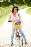 Indian Woman On Cycle Ride In Countryside Royalty Free Stock Photos