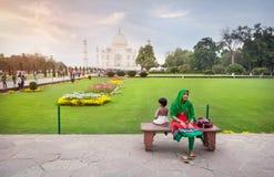 Indian Woman with daughter near Taj Mahal royalty free stock photos