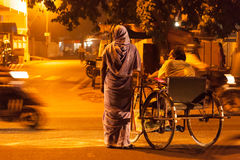 Indian woman with disabled man crossing the street Royalty Free Stock Photo