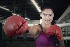 Indian woman does exercise in the ring Royalty Free Stock Photos