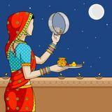 Indian woman doing Karwa Chauth Royalty Free Stock Photo