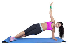 Indian woman doing side plank yoga pose Stock Photography