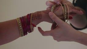 Indian woman dress on bracelet stock video footage