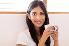 Indian woman drinking coffee Royalty Free Stock Image